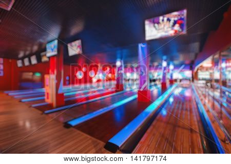 Blurred image of colorful bowling arena with circle light or bokeh. Concept for blur background, competition, hobby, team, defocus.