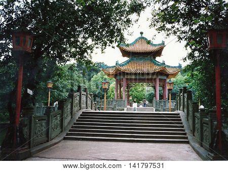 GUANGZHOU / CHINA - CIRCA 1987: A bridge leads to a pavilion in Guangzhou's Yuexiu Park.