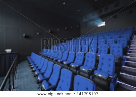 Empty rows of blue theater or movie seats