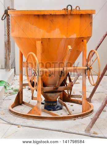 Old yellow color concrete mixer vertical format