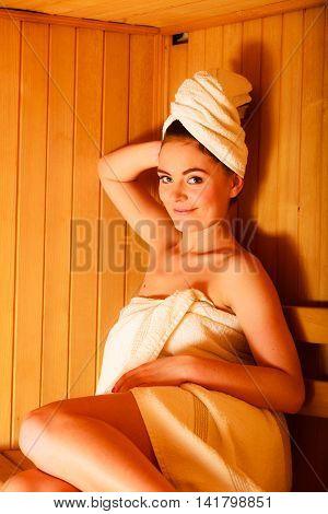 Woman Relaxing In Wooden Sauna Room