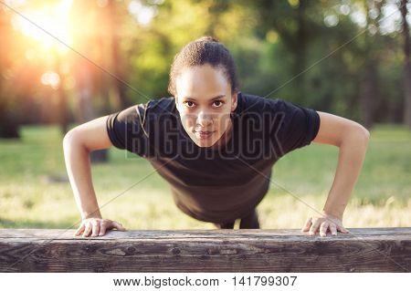 Training Outdoors. Beautiful Sport Woman Doing Pushups.