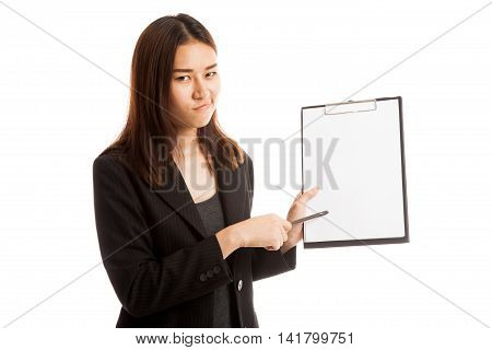 Unhappy Asian Business Woman Point To Clipboard With Pen.