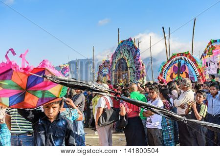 Sumpango Guatemala - November 1 2015: Boy with kite & other visitors at giant kite festival on All Saints' Day honoring spirits of dead.