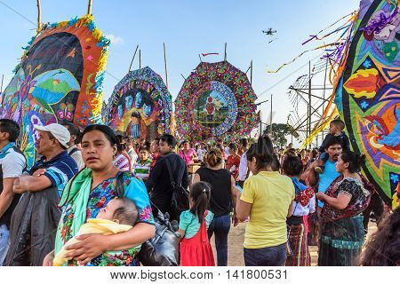 Sumpango Guatemala - November 1 2015: Visitors at giant kite festival on All Saints' Day honoring spirits of dead.