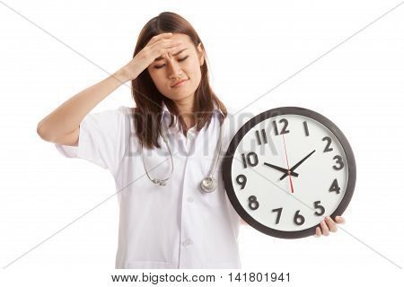 Young Asian Female Doctor Headache With A Clock.