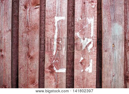 scraps of paper on a wooden wall. the old wooden fence. torn paper ad. cleaning ads. background, texture. empty space for your text