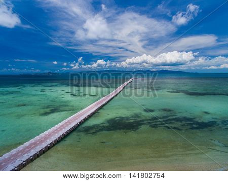 Pontoon bridge stretching into the distance the clouds in deep water