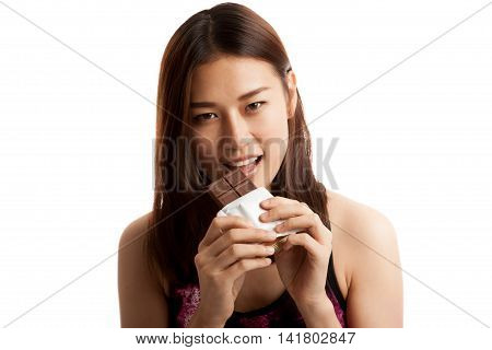 Beautiful Healthy Asian Girl Eat Chocolate.