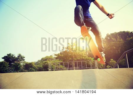 one skateboarder legs skateboarding at skate park