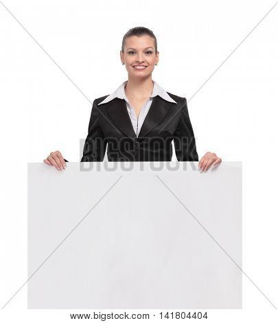 Happy  beautiful business woman showing blank area for sign or c