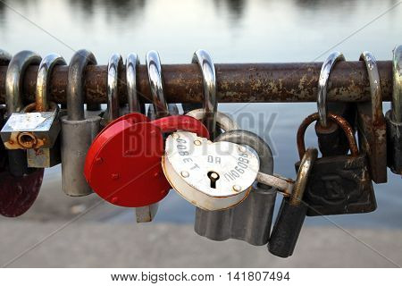 PENZA RUSSIA - AUGUST 12 2012: Locks of newlyweds. Inscription: Council and love