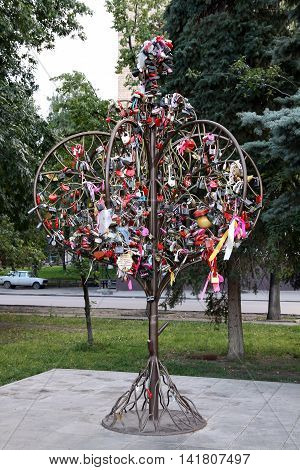 PENZA RUSSIA - AUGUST 12 2012: Metal tree for the for the newlyweds locks standing on the street