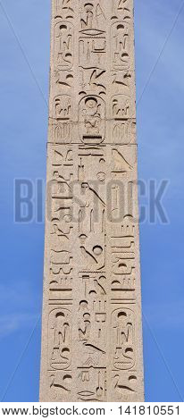 Hieroglyph script on ancient egyptian obelisk in the center of Piazza del Popolo square