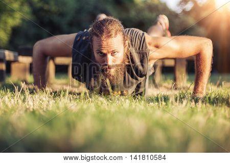 Training Outdoors. Handsome Sport Man Doing Pushups.