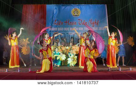 HA NOI, VIET NAM, June 13, 2016 group of young women, folk dance, outside Hanoi, Vietnam