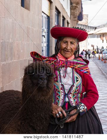 Cusco Woman In Traditional Clothing
