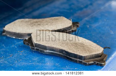 New disk brake pad for replacement on blue blackground