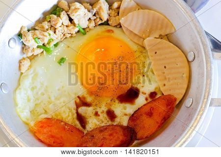 Indochina pan-fried egg with toppings Thai styleegg pan / cooking egg pan concept.Select focus close up.