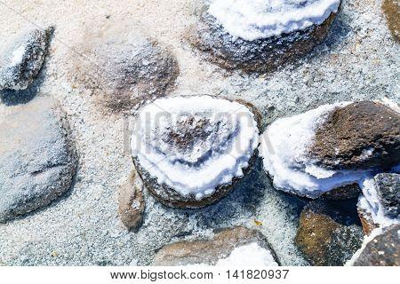 Detail of salt precipitated on rocks in Uyuni Salt Flat Bolivia