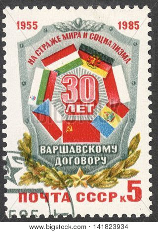 MOSCOW RUSSIA - CIRCA MAY 2016: a post stamp printed in the USSR dedicated to the 30th Anniversary of Warsaw Pact Organization circa 1985
