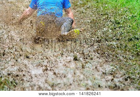 Unrecognizable Man Sliding Down The Dirty Slope