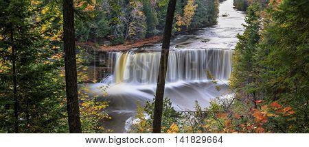 A very picturesque waterfall in motion blur Tahquamenon Falls in autumn Michigan's Upper Peninsula USA