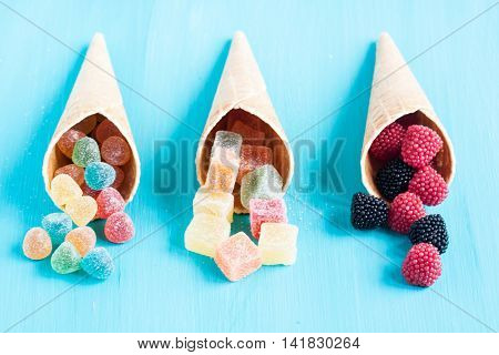 assorted jelly candies on a turquoise background