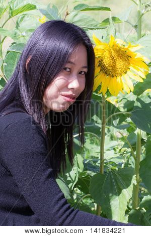 Portrait Thai woman with sunflowers , asian
