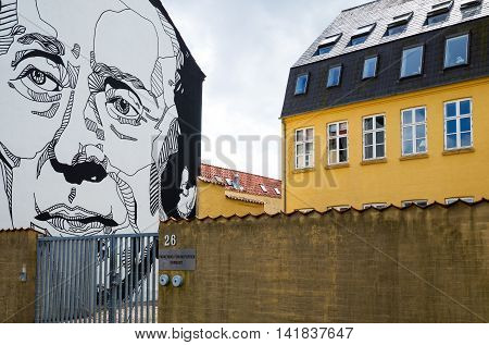 Odense Denmark - July 21 2015: A mural painting in the old city center