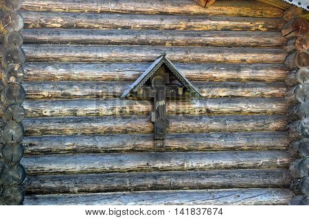 Orthodoxy cross on a background log walls