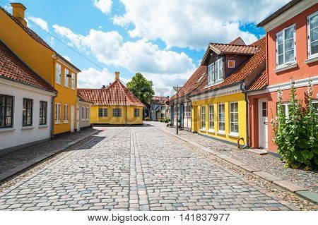 Odense Denmark - July 21 2015: Traditional houses in the old town with the Hans Christian Andersen home in the background left