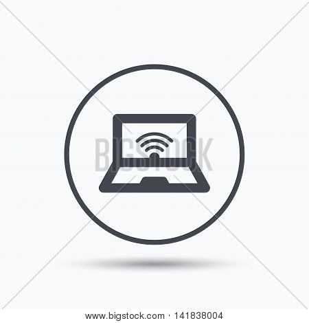 Computer with wifi icon. Notebook or laptop pc symbol. Circle button with flat web icon on white background. Vector