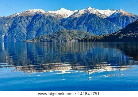 Reflection In Lake Hauroko, New Zealand