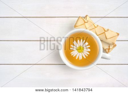 cup of chamomile tea on white wooden table