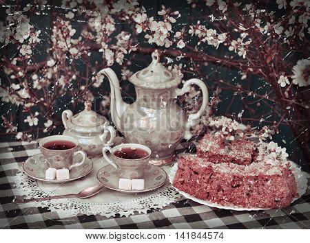 Retro still life with old tea set, sugar, cake and blooming cherry tree, afternoon tea in the spring garden