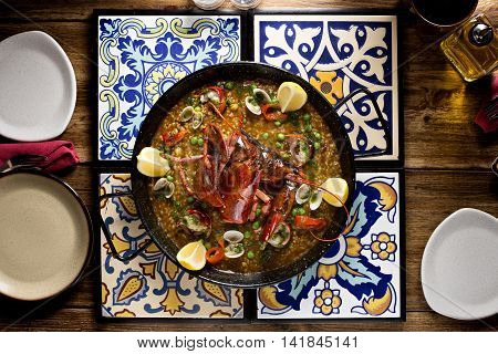 Sauteed lobsters with green beans clams and lemon in Arab table
