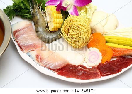 Vietnamese hot pot of shrimp beef fresh fish corn mushroom carrot and dried noodle