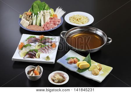 Japanese hot pot of sushi beef pork mushroom tofu noodle and cabbage
