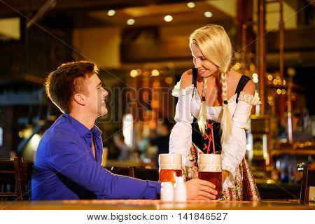 Man and waitress in a pub