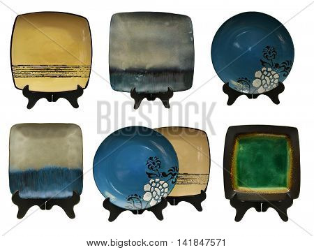 Design set with decorated ceramic plates, japanese culture objects isolated on white