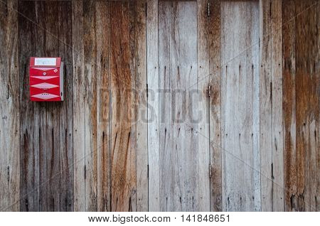 red mailbox on the old wooden door
