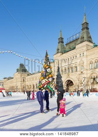 Moscow - November 29 2015: Beautiful Christmas ice rink on Red Square and a lot of people are skating in the holidays and unusual Christmas tree November 29 2016 Moscow Russia