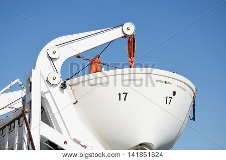 Bow of lifeboat with blue sky in background
