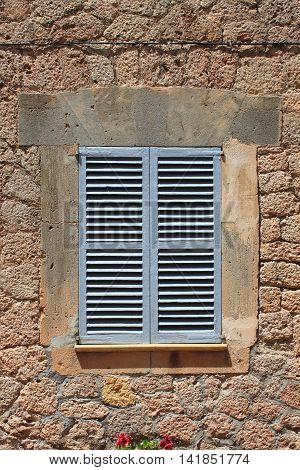 Italian style shutters in a old medieval palace