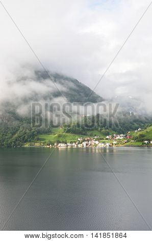 Norwegian Village in fjord on cloudy day