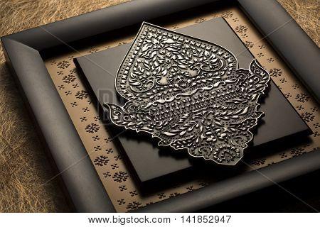 Indonesian plaque featuring pohon beringin puppet in black