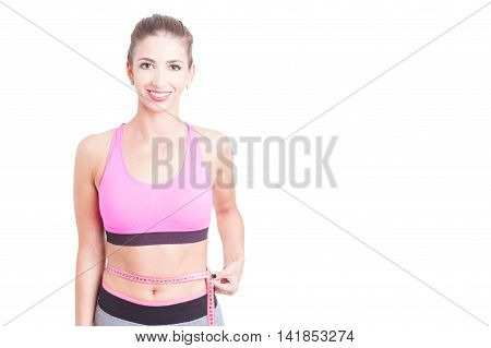 Lady At Gym Holding Tape Line Around Waist