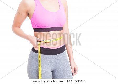 Girl Wearing Sportswear Measuring Her Waist
