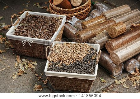 Wicker baskets with different kinds of pelleted compound feed on agricultural exhibition